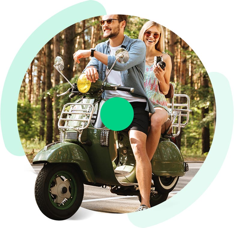 Couple Sitting On Scooter